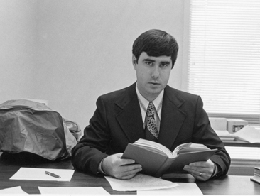 Perry Roquemore, 1974, at desk with book